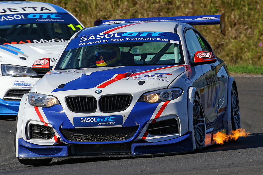 A flame from Johan Fourie's EPS Courier Service BMW GTC at the recent third round of the championship in East London. He'll be hoping to turn the heat up even more at Zwartkops Raceway. - Picture by Reynard Gelderblom
