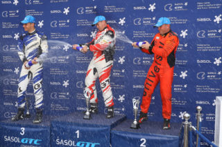 Adrian Wood celebrating on the top step of the Sasol GTC2 podium. Picture: Reynard Gelderblom