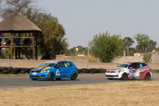 Ian Pepper and Stiaan Kriel battling it out during the second race of the day - Picture by Paul Bedford