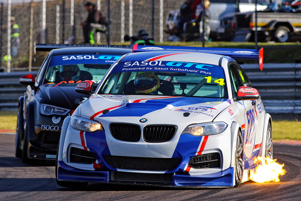 Johan Fourie closely pursued by eventual winner Michael Stephen during the second Sasol GTC race - Picture by Paul Blackburn