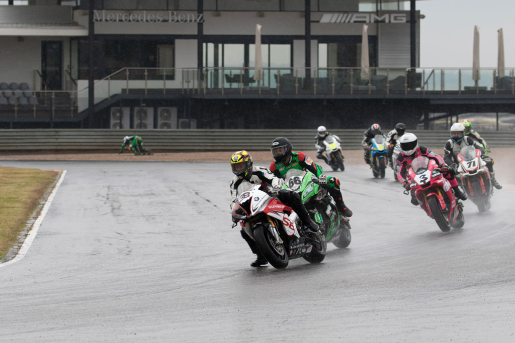 Lance Isaacs tries to keep upright on the SuperGP warm-up lap - Picture by Paul Bedford
